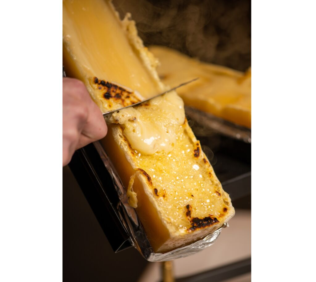 Cheese raclette at the restaurant Gigers at the Hotel Waldhaus Sils