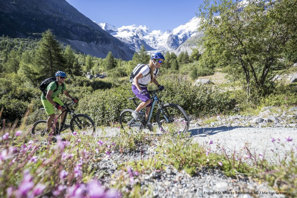Mountain bikers on the way to the Morteratsch Glacier.