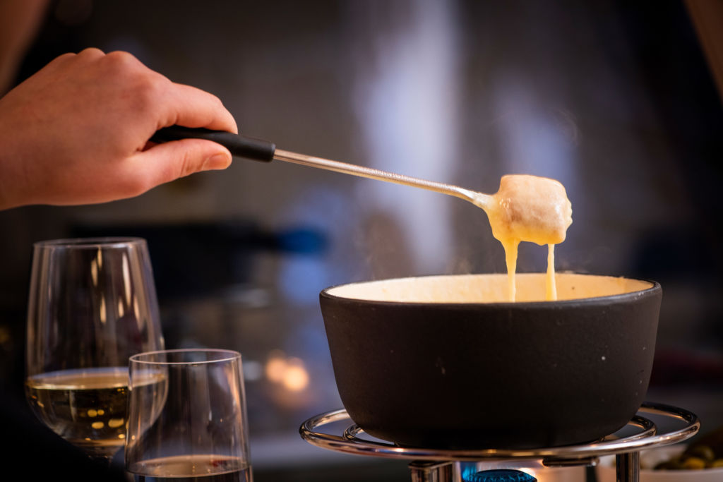 Cheese fondue at the restaurant Gigers at the Hotel Waldhaus Sils